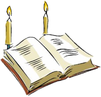 A bible with two candles
